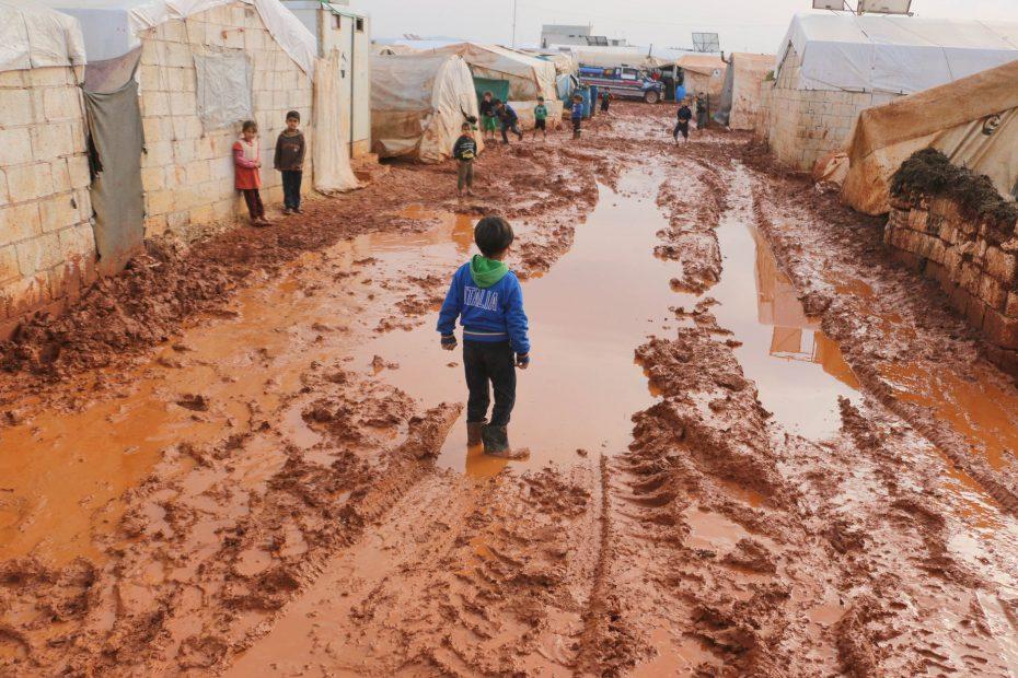 refugee kids on dirty ground